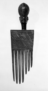 Chokwe. Comb, 20th century. Wood, 6 x 1 3/4 x 1 1/2 in. (15.3 x 4.5 x 3.5 cm). Brooklyn Museum, Gift of Mr. and Mrs. John McDonald, 75.193.1. Creative Commons-BY