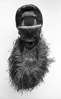 Pende (Western). Mask (Mbuya) with Long Beard (Kinoyo-Muyombo), late 19th-early 20th century. Wood, fiber, raffia, pigment, 24 1/2 x 10 1/2 x 5 1/2 in. (62.2 x 26.7 x 14.0 cm). Brooklyn Museum, Gift of Mr. and Mrs. John McDonald, 75.193.2. Creative Commons-BY