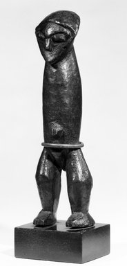Zande. Yanda Figure (Nazeze Type), late 19th or early 20th century. Wood, copper alloy, 7 1/8 x 2 x 1 3/4 in. (18.2 x 4.9 x 4.3 cm). Brooklyn Museum, Purchased with funds given by Evelyn A. Jaffe Hall Charitable Trust, 75.75.4. Creative Commons-BY