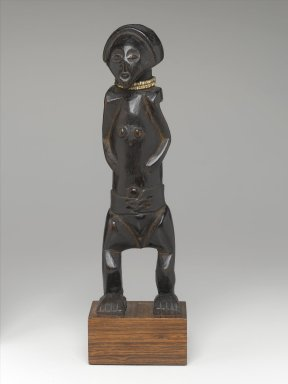 Zande. Yanda Figure (Nazeze Type), 20th century. Wood, plastic beads, 11 1/2 x 3 1/2 x 2 1/2 in. (29.5 x 8.7 x 6.3 cm). Brooklyn Museum, Gift of Marcia and John Friede, 75.82.5. Creative Commons-BY