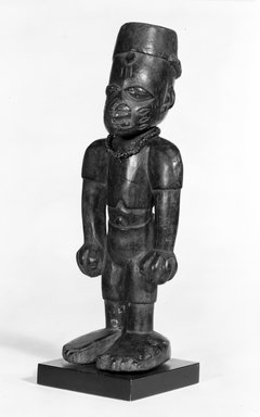 Yoruba. Standing Male Figure (Ere Ibeji), late 19th or early 20th century. Wood, pigment, glass beads, h: 9 1/2 in. (24 cm). Brooklyn Museum, Gift of Mr. and Mrs. E. H. Polak, 75.86.2. Creative Commons-BY