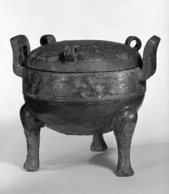 Tripod Vessel with Lid, 1100-256 B.C. Cast bronze, 8 1/4 x 9 1/2 in. (21 x 24.1 cm). Brooklyn Museum, Anonymous gift, 76.154.1a-b. Creative Commons-BY
