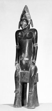 Senufo. Seated Female Figure (Tugubele), early 20th century. Wood, pigment, 34 1/2 x 8 1/4 x 6 3/4 in. (87.6 x 21.0 x 17.1 cm). Brooklyn Museum, Gift of Mr. and Mrs. Milton F. Rosenthal, 76.167.1. Creative Commons-BY