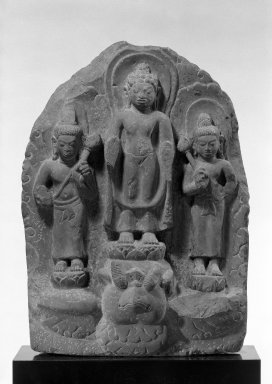 Possibly Mon-Dvaravati. Buddha and Attendants, 7th century or later. Gray stone, 18 x 13 1/2 in. (45.7 x 34.3 cm). Brooklyn Museum, Gift of Emily Manheim Goldman, 76.178.2. Creative Commons-BY