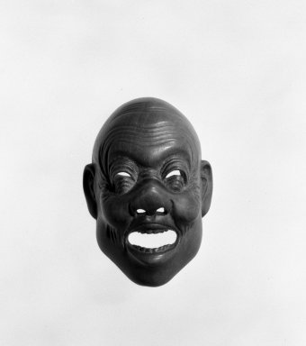 Netsuke in the form of a Mask, early 20th century. Boxwood, 1 3/8 x 1 3/4 in. (3.5 x 4.5 cm). Brooklyn Museum, Hon. and Mrs. Leon Polsky , 76.184.2. Creative Commons-BY