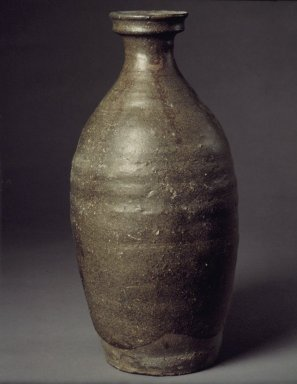 Bottle, late 11th-12th century. Stoneware with celadon glaze, 11 1/2 x 5 3/8 x 2 9/16 in. (29.2 x 13.7 x 6.5 cm). Brooklyn Museum, Gift of Robert Sistrunk, 76.45. Creative Commons-BY