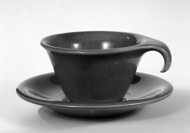 Russel Wright (American, 1904-1976). Cup and Saucer, ca. 1945. Glazed china, 2 x 3 1/2 in. (5.1 x 8.9 cm). Brooklyn Museum, Gift of Russel Wright, 76.99.36a-b. Creative Commons-BY