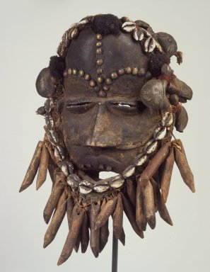 We. Face Mask, late 19th or early 20th century. Wood, cloth, copper alloy, shells, hair, cordage, ferrous nails, accumulated materials, 12 x 8 1/4 x 5 1/4 in. (30.5 x 21 x 13.3 cm). Brooklyn Museum, Gift of Mr. and Mrs. J. Gordon Douglas III, 77.173.4. Creative Commons-BY