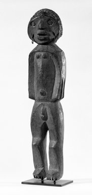 Tiv. Standing Figure, early 20th century. Wood, metal, resin, 21 1/4 x 4 3/4 x 4 1/2 in. (54.0 x 12.2 x 11.5 cm). Brooklyn Museum, Gift of Dr. and Mrs. Abbott A. Lippman, 77.177.1. Creative Commons-BY