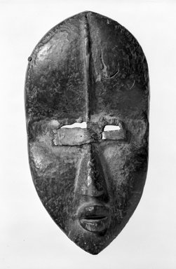 Dan. Mask, late 19th-early 20th century. Wood, metal, Other: 11 1/4 x 6 x 3 in. (28.6 x 15.2 x 7.6 cm). Brooklyn Museum, Gift of Marcia and John Friede, 77.243.4. Creative Commons-BY
