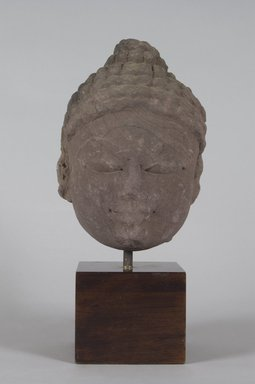 Head of a Jina, 10th-11th century. Sandstone, 8 3/4 x 5 3/4 in. (22.2 x 14.6 cm). Brooklyn Museum, Gift of Emily Manheim Goldman, 77.259.5. Creative Commons-BY