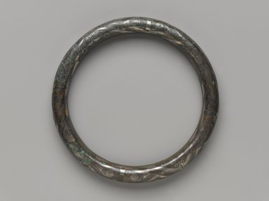Ring-Shaped Object, 1100-256 B.C.E. Bronze, inlaid with silver, 4 5/8 in. (11.7 cm). Brooklyn Museum, Gift of Mr. and Mrs. Alastair B. Martin, the Guennol Collection, 77.54.2a-b. Creative Commons-BY