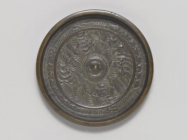 Mirror, 15th century. Cast bronze, 7/16 x 4 1/2 in. (1.1 x 11.4 cm). Brooklyn Museum, Designated Purchase Fund, 77.55.3. Creative Commons-BY