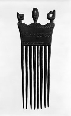 Asante. Comb with Head, Sankofa Bird and Clenched Fist, late 19th or early 20th century. Wood, height: 8 1/16 in. (20.5 cm). Brooklyn Museum, Gift of Mr. and Mrs. William W. Brill, 77.79.2. Creative Commons-BY