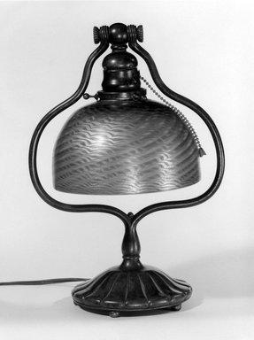 Tiffany Studios (1902-1932). Lamp, 1905-1938. Bronze, opalescent glass, Lamp: 13 1/2 x 5 5/8 in. (34.3 x 14.3 cm). Brooklyn Museum, Bequest of Carl Otto von Kienbusch, 77.86.5. Creative Commons-BY