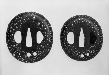 Pair of Sword Guards, 19th century. Iron, silver, .A: 3 1/8 x 2 3/4 in. (8 x 7 cm). Brooklyn Museum, Gift of Mr. and Mrs. Arthur Wiesenberger, 77.98a-b. Creative Commons-BY