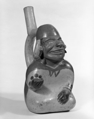 Moche. Stirrup Spout Vessel in Form of a Seated Figure. Ceramic, pigment Brooklyn Museum, Gift of Mr. and Mrs. Paul B. Taylor, 78.118.43. Creative Commons-BY