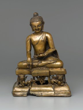 Seated Buddha Sakyamuni, 12th century. Bronze, silver inlay., Height: 11 1/2 in. (29.2 cm). Brooklyn Museum, Gift of Gustave Schindler, 78.147. Creative Commons-BY