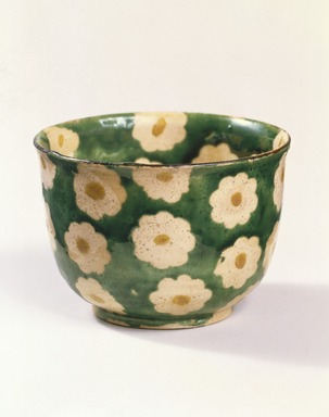 Ogata Kenzan (Japanese, 1663-1743). Mukozuke (Sweetmeat dish), 18th century. Stoneware with enamel background and paper-resist blossoms with enamel centers, 2 3/16 x 3 1/8 in. (5.6 x 7.9 cm). Brooklyn Museum, Purchase gift of the J. Aron Charitable Foundation, Inc., 78.208. Creative Commons-BY
