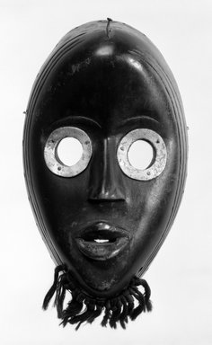 Dan. Gunyega Mask, late 19th-early 20th century. Wood, metal, 8 7/8 x 5 1/2 x 3 in. (22.5 x 14 x 7.6 cm). Brooklyn Museum, Gift of the Edwards-Britt Collection, 78.238.3. Creative Commons-BY