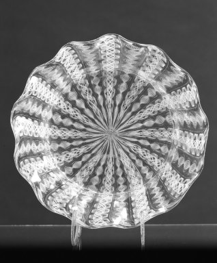 Boston and Sandwich Glass Company. Bowl, ca. 1850. Filigree glass, 1 3/8 x 6 1/4 in. (3.5 x 15.9 cm). Brooklyn Museum, Gift of Allison C. Paulsen in memory of Arthur W. Clement, 78.242.13. Creative Commons-BY