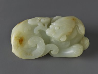 Carving of a Recumbent Mythical Beast, late 18th- early 19th century. Nephrite, 1 3/8 x 3 1/2 in. (3.5 x 8.9 cm). Brooklyn Museum, Gift of Stanley Herzman, 78.85.7. Creative Commons-BY