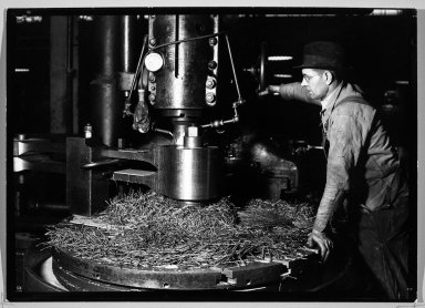 Lewis Wickes Hine (American, 1874-1940). [Untitled] (Man in Hat Standing at Machine), 1936-1937. Gelatin silver photograph, 4 3/4 x 7 1/4 in.  (12.1 x 18.4 cm). Brooklyn Museum, Gift of the National Archives, 79.143.142