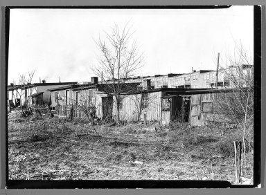 Lewis Wickes Hine (American, 1874-1940). [Untitled] (Shanties and Leafless Trees), 1936-1937. Gelatin silver photograph, 4 3/4 x 7 1/4 in.  (12.1 x 18.4 cm). Brooklyn Museum, Gift of the National Archives, 79.143.56