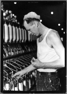 Lewis Wickes Hine (American, 1874-1940). [Untitled] (Man in Cap Holding Thread), 1936-1937. Gelatin silver photograph, 7 1/4 x 4 3/4 in. (18.4 x 12.1 cm). Brooklyn Museum, Gift of the National Archives, 79.143.61