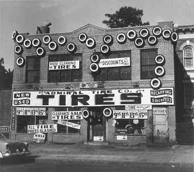 N. Jay Jaffee (American, 1921-1999). Tire Store (Pennsylvania Ave., Brooklyn), 1955. Gelatin silver photograph, 7 3/8 x 8 3/8 in. (18.7 x 21.3 cm). Brooklyn Museum, Gift of the artist, 79.47.7. © The N. Jay Jaffee Trust