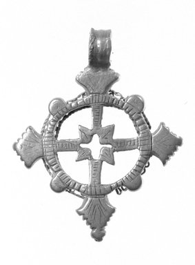 Amhara. Pendant Cross, 19th or 20th century. Silver, 2 x 1 5/8 in. (5.0 x 4.2 cm). Brooklyn Museum, Gift of George V. Corinaldi Jr., 79.72.11. Creative Commons-BY