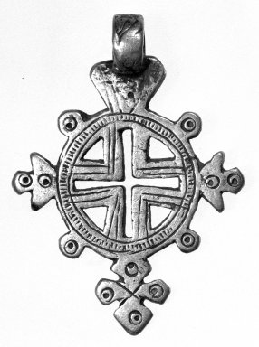 Amhara. Pendant Cross, 19th or 20th century. Silver, 1 3/4 x 1 1/4 in. (4.6 x 3.3 cm). Brooklyn Museum, Gift of George V. Corinaldi Jr., 79.72.33. Creative Commons-BY