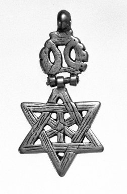 Amhara. Pendant in form of Star of David, 19th or 20th century. Silver, 2 1/8 x 1 1/8 in. (5.3 x 2.8 cm). Brooklyn Museum, Gift of George V. Corinaldi Jr., 79.72.7. Creative Commons-BY