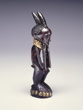 Nsapo-Nsapo. Squatting Male Figure, late 19th century. Wood, copper alloy, glass beads, fiber, organic materials, 7 1/2 x 1 3/4 x 2 in. (19.1 x 4.4 x 5.1 cm). Brooklyn Museum, Purchased with funds given by Frieda and Milton F. Rosenthal and Carll H. de Silver Fund, 80.100. Creative Commons-BY