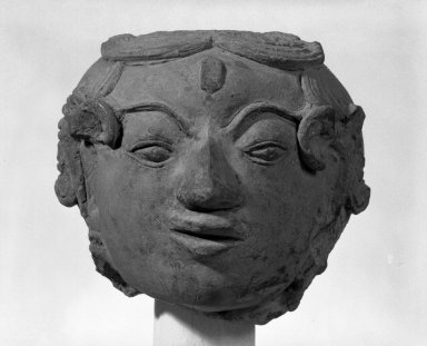 Female Head, 14th century. Terracotta, 6 x 6 x 8 in. (15.2 x 15.2 x 20.3 cm). Brooklyn Museum, Gift of William Bransford Blundin, 80.114. Creative Commons-BY