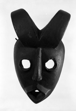 Ogoni. Face Mask with Two Curved Horns, early 20th century. Wood, 9 3/4 x 6 x 4 1/2 in. (24.7 x 15.3 x 11.4 cm). Brooklyn Museum, Gift of Dr. and Mrs. Abbott A. Lippman, 80.152. Creative Commons-BY