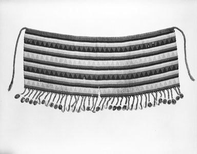 Kirdi (ie. Gisinga, Motu, Gude, Glidder, Fali). Cache Sexe/Apron, late 19th or early 20th century. Cotton fiber, glass beads, cowrie shells, metal, fiber, 21 in. (53.3 cm) x 10 1/2in. (26.7cm). Brooklyn Museum, Gift of Jay M. Haft, 80.243.2. Creative Commons-BY