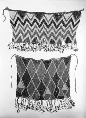 Kirdi (ie. Gisinga, Motu, Gude, Glidder, Fali). Cache Sexe/Apron, early 20th century. Cotton, glass beads, cowrie shells, metal, fiber, 18 1/2 x 10 in. (47 x 25.4 cm). Brooklyn Museum, Gift of Jay M. Haft, 80.243.9. Creative Commons-BY