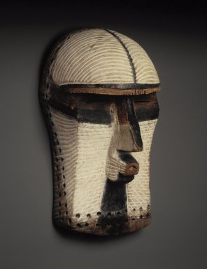 Possibly Songye. Mask (Kifwebe), late 19th or early 20th century. Wood, pigments, pyro, cordage, 15 3/4 x 8 x 8 1/4 in. (40.0 x 20.0 x 21.0 cm). Brooklyn Museum, Gift of Mr. and Mrs. Bernard Leyden, 81.165. Creative Commons-BY