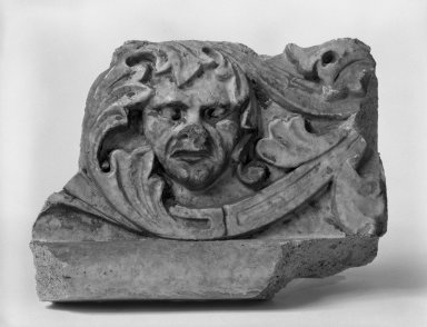 Unknown American. Foliate Border with Head, from Turner Towers, 135 Eastern Parkway, Brooklyn, 1928. Cast Stone: cement composition and vitreous enamel, Other: 8 x 8 x 10 1/2 in. (20.3 x 20.3 x 26.7 cm). Brooklyn Museum, Gift of Charles Free, 81.209.11. Creative Commons-BY