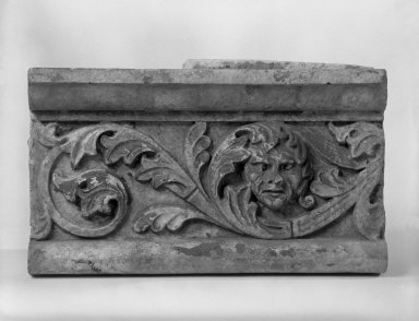Unknown American. Foliate Border with Head, from Turner Towers, 135 Eastern Parkway, Brooklyn, 1928. Cast Stone: cement composition and vitreous enamel, Other: 7 3/4 x 13 1/2 x 5 in. (19.7 x 34.3 x 12.7 cm). Brooklyn Museum, Gift of Charles Free, 81.209.9. Creative Commons-BY