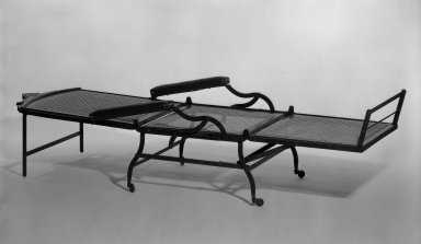 Cavedra B. Sheldon. Folding Invalid Chair, Patented 1876; Made ca. 1876-1895. Iron, walnut, and new caning and upholstery, Open: 46 3/4 x 27 x 77 1/4 in. (118.7 x 68.6 x 196.2 cm). Brooklyn Museum, H. Randolph Lever Fund, 81.34. Creative Commons-BY