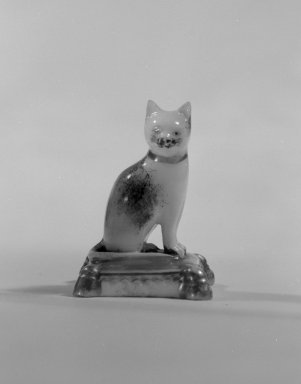 Figure of a Cat, ca. 1826-1830. Porcelain, 1 1/2 x 1 1/8 x 1 1/8 in. (3.8 x 2.9 x 2.9 cm). Brooklyn Museum, Bequest of Dr. Grace McLean Abbate, 81.53.10. Creative Commons-BY