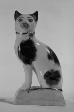 Figure of a Cat, ca.  1960. Lead-glazed earthenware, 3 3/4 x 2 1/4 x 1 3/4 in. (9.5 x 5.7 x 4.4 cm). Brooklyn Museum, Bequest of Dr. Grace McLean Abbate, 81.53.12. Creative Commons-BY