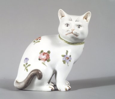 Figure of a Cat, body: possibly 19th century, decoration: 20th century. Hard-paste porcelain, 5 1/4 x 5 x 3 1/2 in. (13.3 x 12.7 x 8.9 cm). Brooklyn Museum, Bequest of Dr. Grace McLean Abbate, 81.53.17. Creative Commons-BY