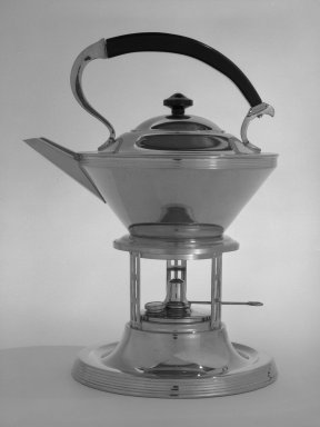 Manning Bowman and Co. (1857-present). Tea Kettle on Stand, ca. 1935. Chromed metal (possibly brass), wood, 12 x 9 x 7 1/2 in. (30.5 x 22.9 x 19.1 cm). Brooklyn Museum, Robert B. Woodward Memorial Fund, gift of Emma Engdahl Swanson and Designated Purchase Fund, 82.114a-g. Creative Commons-BY