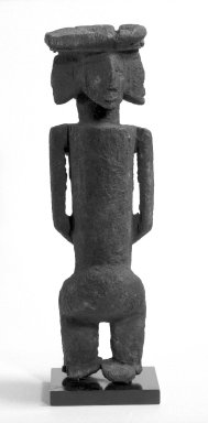 Dogon. Figure with Four Faces (Ginin), late 19th or early 20th century. Wood, iron, sacrificial materials, 14 1/4 in. (32.6 cm). Brooklyn Museum, Gift of Avery Eliscu, 82.155. Creative Commons-BY