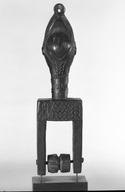 Baule. Heddle Pulley with Female Head, late 19th or early 20th century. Wood, 8 1/8 x 2 1/8 x 1 7/8 in.  (20.6 x 5.4 x 4.8 cm). Brooklyn Museum, Gift of Dr. Henry Fischer, Jr., 82.213.1. Creative Commons-BY