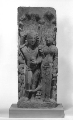 Nagaraja and Nagini, 11th-12th century. Sandstone, 25 1/2 x 10 in. (64.8 x 25.4 cm). Brooklyn Museum, Gift of Dr. and Mrs. George Liberman, 82.236. Creative Commons-BY