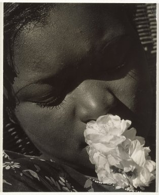 Consuelo Kanaga (American, 1894-1978). Frances with a Flower, early 1930s. Gelatin silver photograph, Image: 10 5/8 x 8 in. (27 x 20.3 cm). Brooklyn Museum, Gift of Wallace B. Putnam from the Estate of Consuelo Kanaga, 82.65.10